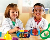 Kids playing science