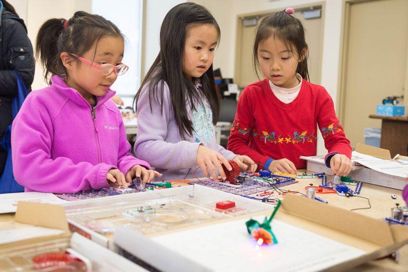 kids interact with stem kits