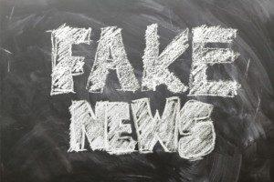 Fake News written on a chalkboard