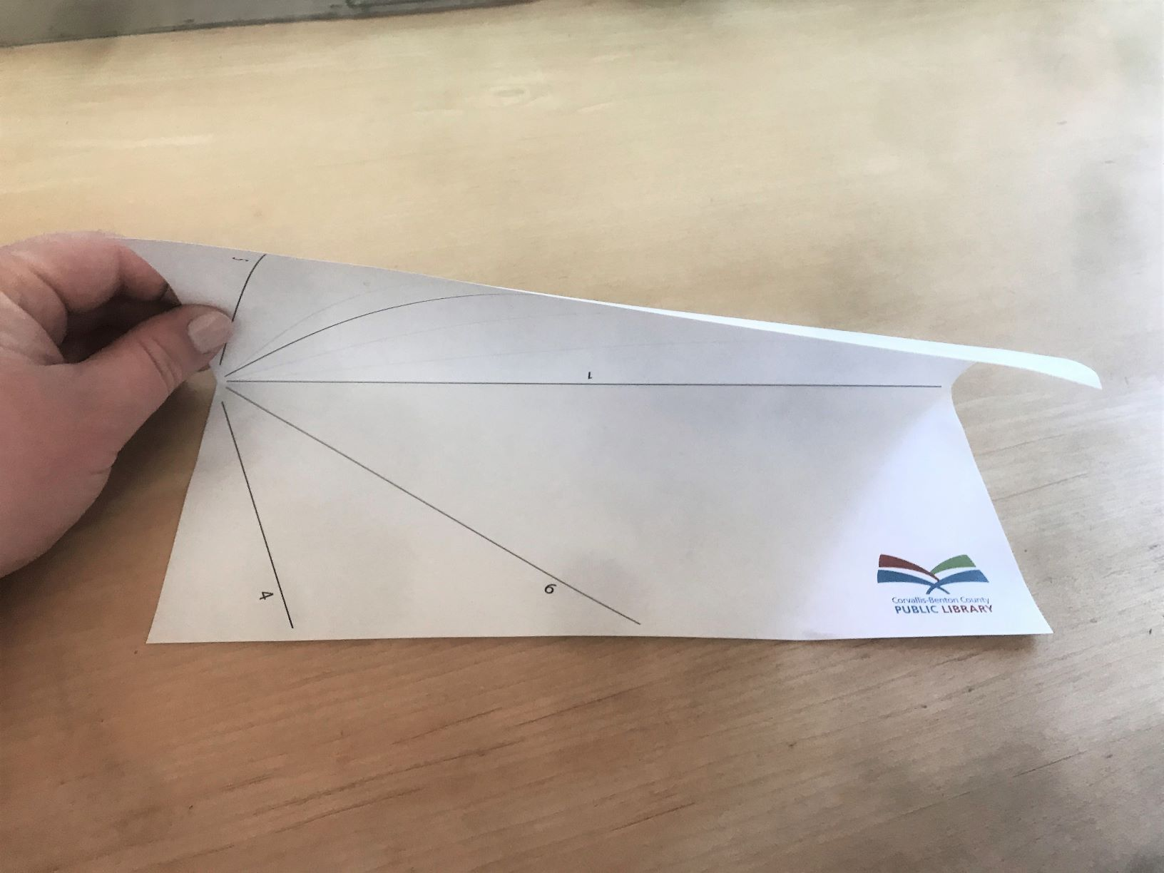Photo of paper airplane step 1