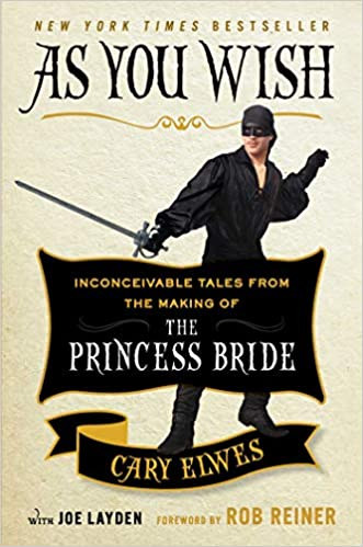 As you wish book cover - Cary Elwes dressed up as the man in black holding a sword from the movie the Princess Bride.